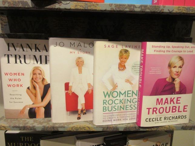 Detail of book covers, women and leadership display on shelf at Waterstones Glasgow: white, blonde, pink and power themed.