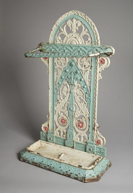 Reputedly decorated by suffragettes in Duke St Prison, the elaborate curling patterns of this cast iron umbrella stand have been painted in the suffrage colours, now faded to white, pale geen and pink.