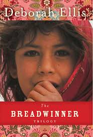 book cover with dark red header and footer, includes image of pakistani child