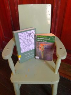 A book of selected letters by Catherine Carswell and 'Open the Door' sit on a small chair.