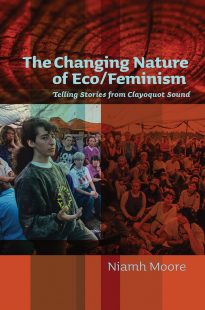 The cover of The Changing Nature book. The background is a reddish orange colour, and the title is a light blue colour. The image in the centre of the book is divided into two, the right side is in colour depicting a woman in the foreground facing sideways and extending her hand out. She is surrounded by a group of women sitting all around her. The left part of the image is coloured red and shows the crowds of women sitting together at this event.
