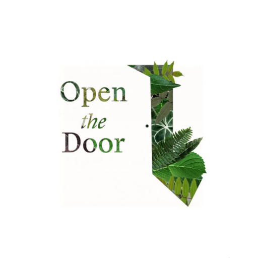 An open door with green leaves emerging through.