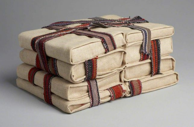 Eight books wrapped in cloth