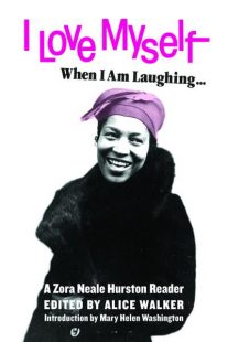 Black and white image of the author laughing. She is wearing a pink headscarf. The title is in pink letter on a white background