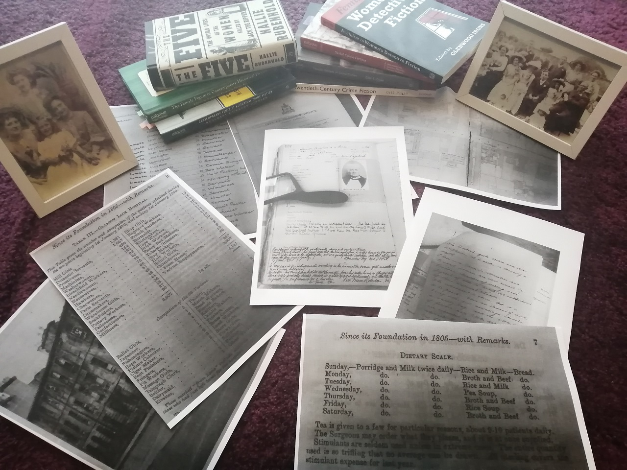Research Materials for the historical crime fiction novellas. Credit: Donna Moore. Includes photographs, books and scanned pages.