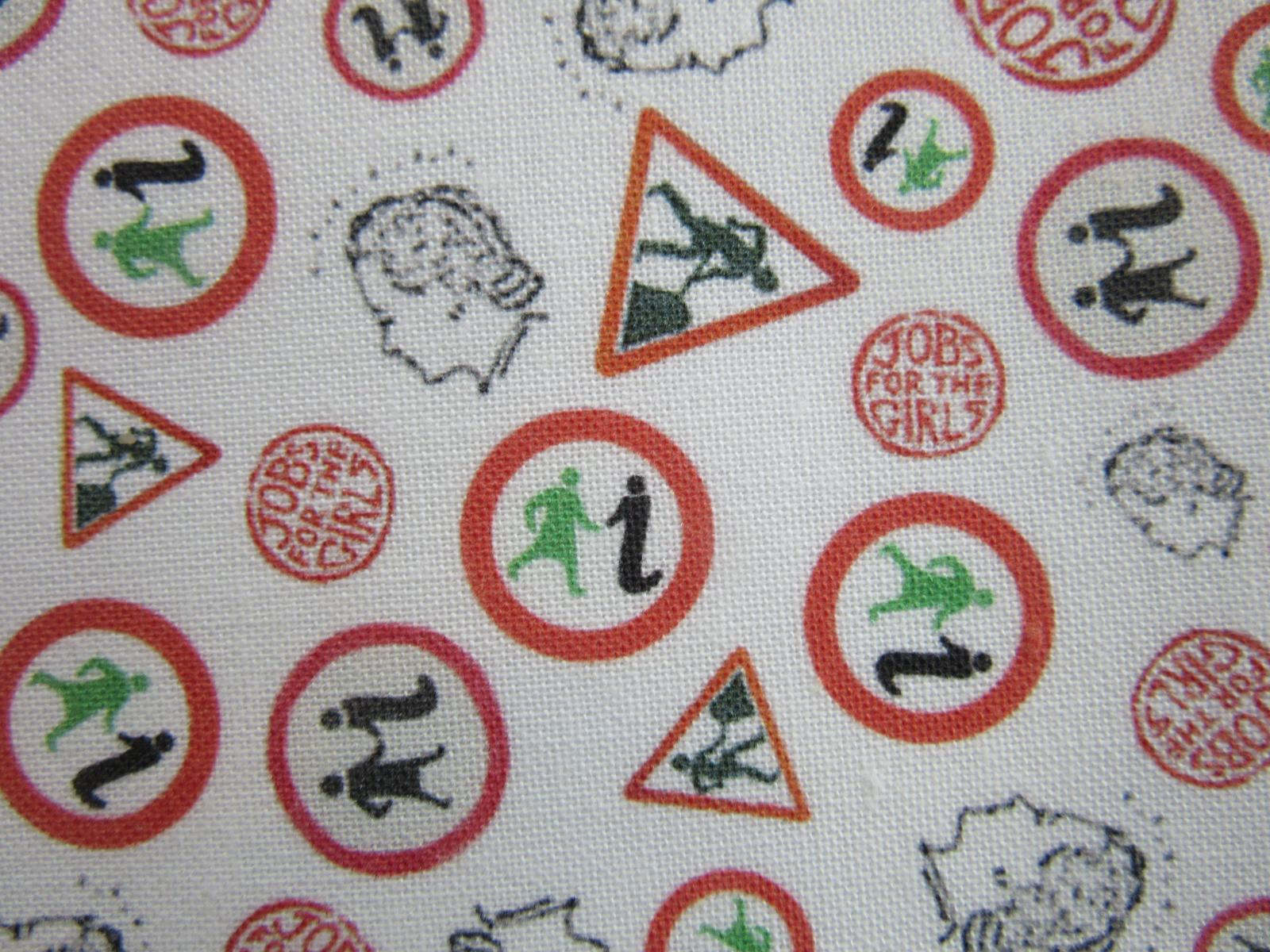 Patterned fabric design for our GWL facemasks, with different logos from GWL history in red, green and black on a white background.