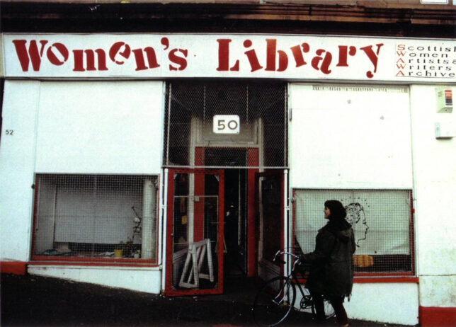 Old photograph of a shop front in Garnethil with a a sign reading Women's Library in uneven text