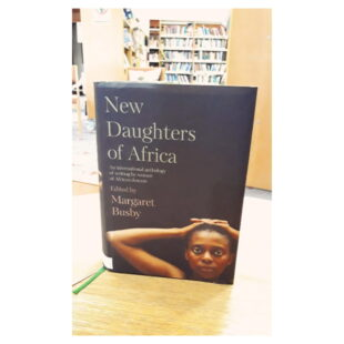 """the book """"New daughters of Africa"""" sits on a shelf"""