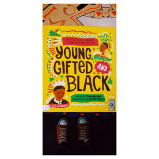 """a bright yellow book cover with colourful illustrations. the book is """"Young Gifted and Black"""""""