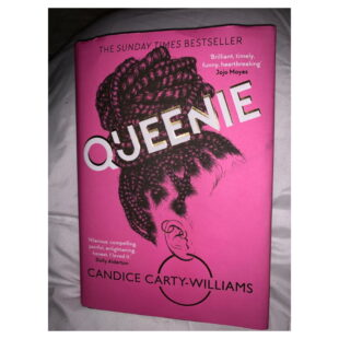 """the book """"Queenie"""" is bright pink with the outline of a woman's face and hair"""