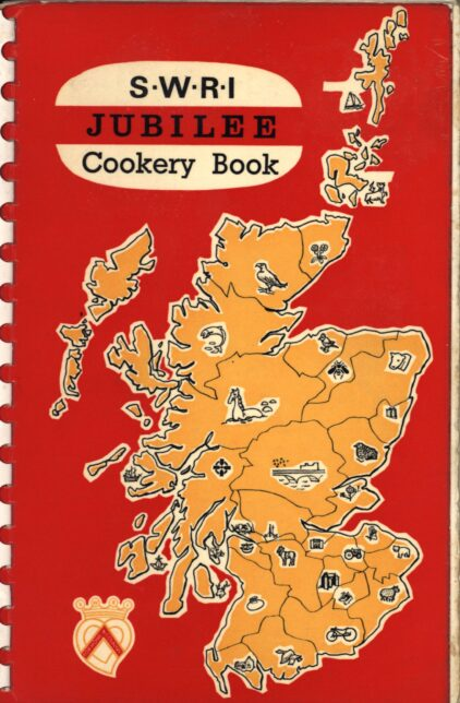 """A red book cover with an orange map of Scotland, the book is titled """"S.W.R.I JUBILEE Cookery Book"""""""