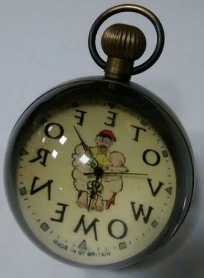 """a pocket watch where the numbers are replaced by letters which read, clockwise, """"V O T E S F O R W O M E N"""""""