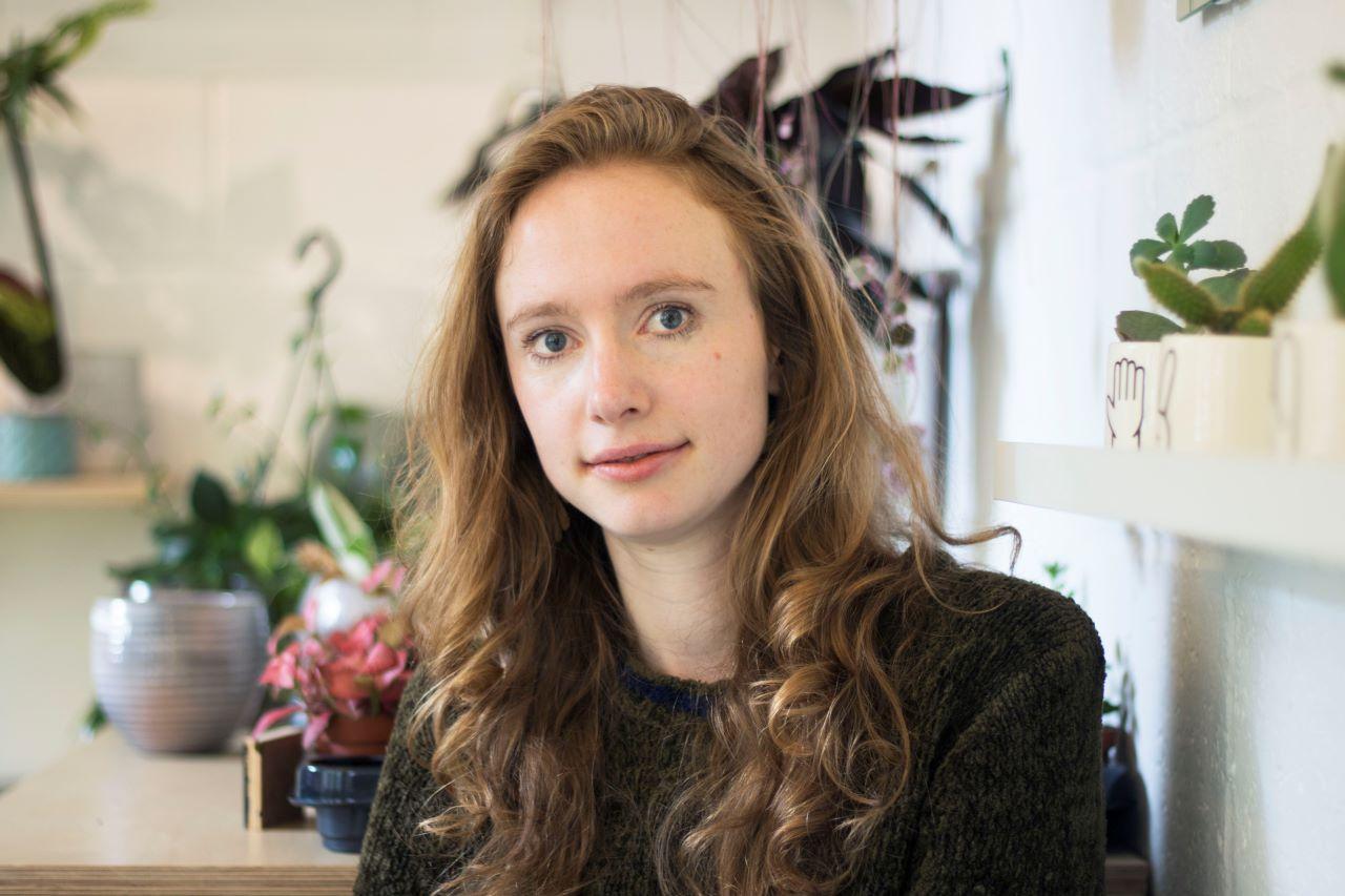 Headshot of the author Molly Aitken.