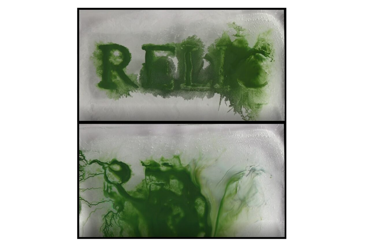 A film still shows two panels, with green ink. On one of them, the letters RELIC can just be made out as the ink is bleeding and blurring away.
