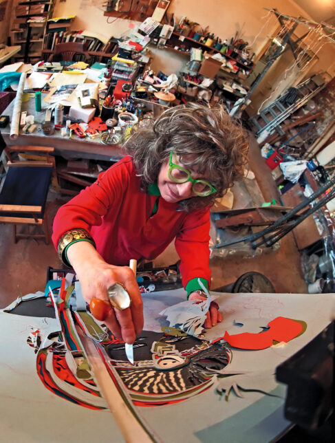 Edith Simon in her studio working on a scalpel painting