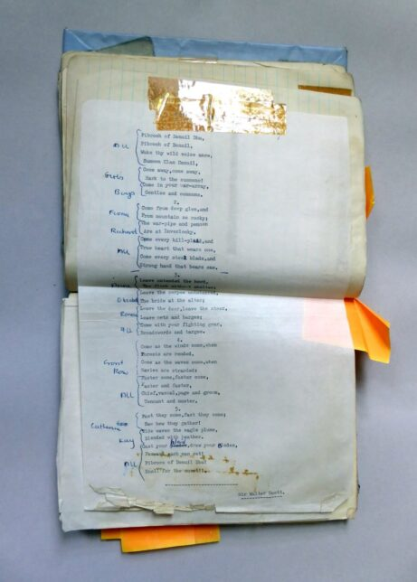 Typed choral verse stuck with Sellotape into a lined notebook