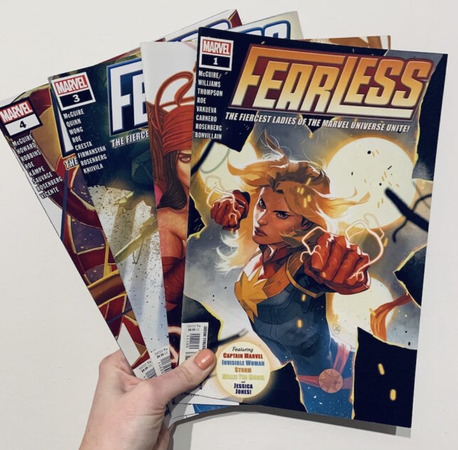 Image shows four Fearless issues. Issue most visible to viewer has Captain Marvel illustration. Lightning comes from her fists and she is in combat mode.