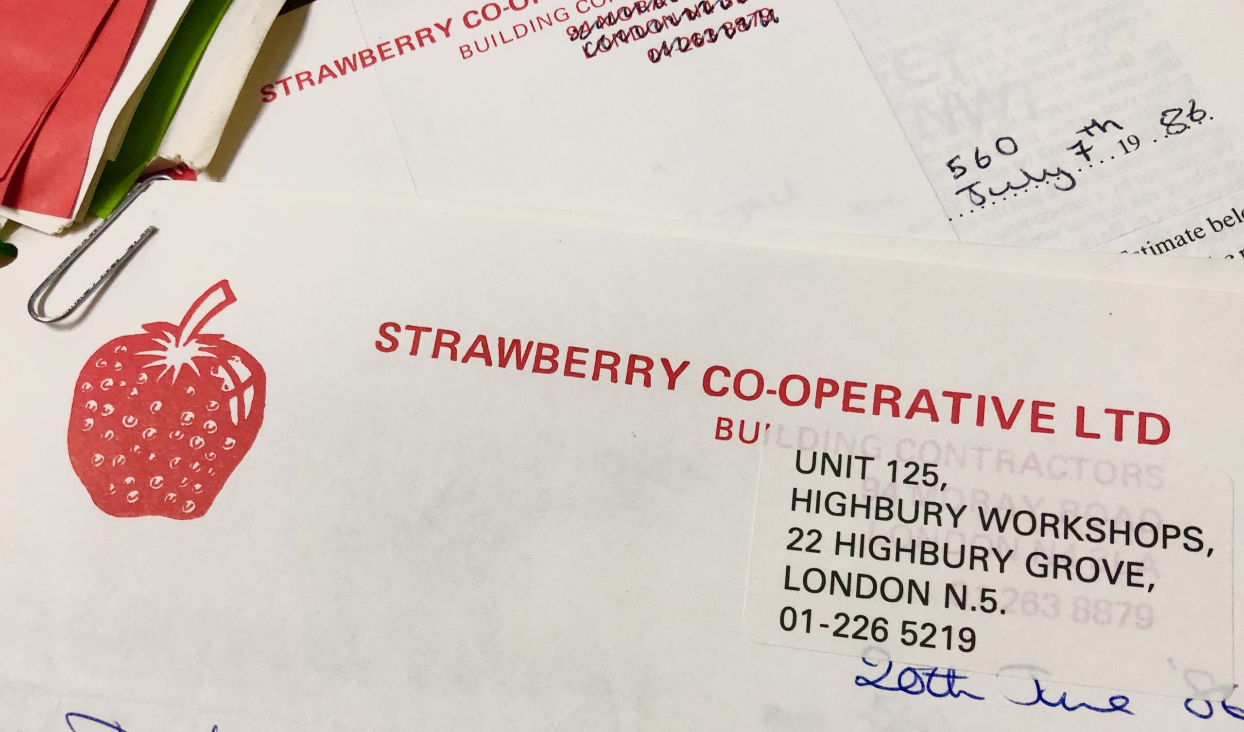 Letterhead of Strawberry Builders Co-operative, featuring their name in bright red all caps block type and to the left of that, a red illustration of a strawberry.