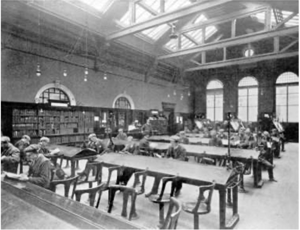 Image of the interior of the Bridgeton Public Library, inside the men's general reading room. The ceilings are high with bookshelves on one side of the room and large desks taking up most of the interior space.
