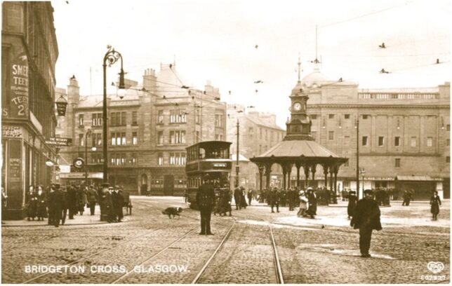 Image of Bridgeton Cross, taken around 1912. The image shows the street and the tram line through the area. It is intended to highlight the grandeur of the area to show its wealth during its industrial peak.