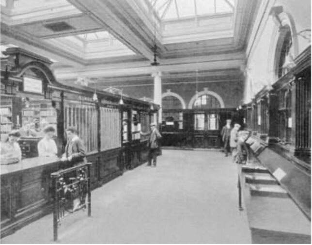 Interior of the Bridgeton Public Library, including a front desk where books would be selected for visitors