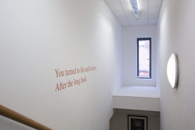 The stairway to our archive mezzanine, with words by Jackie Kay.